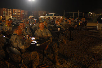 Photo: Soldiers enjoy made-to-order steaks, grilled by members of the organization Serving Our Troops, during an event designed to bring Soldiers and their families together and thank them for their support and service at Contingency Operating Base Basra, Dec 12.