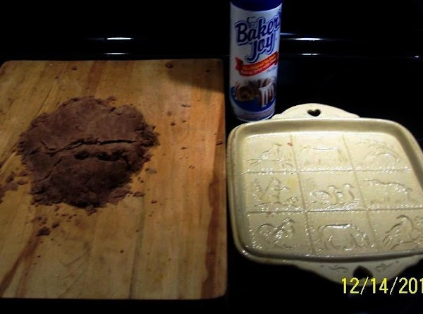 Knead the dough on a unfloured board  until snooth. Spray the pan-mold very lightly with...