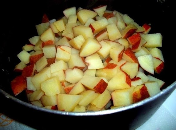 Drain cooked potatoes and place back into pot, toss to coat with vinegar. Let...