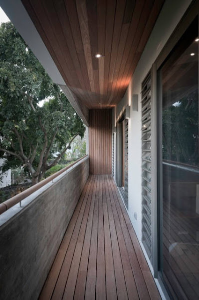"""Photo: A strong dialogue between the residences is generated through the use of similar façade panel materials; the """"recycled"""" house in the form of recuperated demolition timbers of various sizes from previous buildings and the """"new"""" from reconstituted timbers in a more uniform sustainable way. More in AD: http://archdai.ly/LfI1yc"""