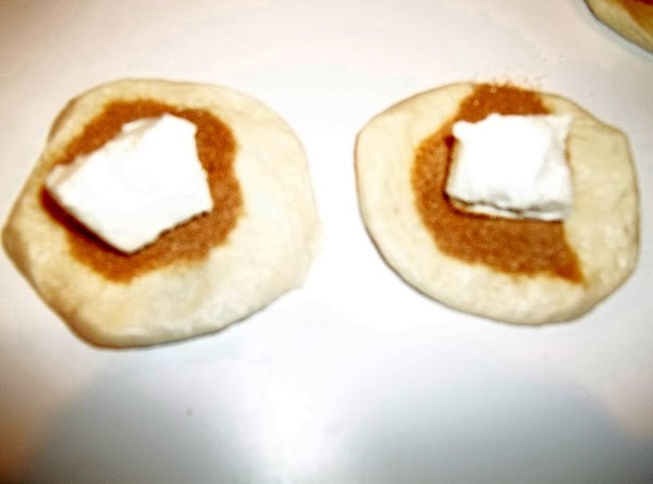 Cut the cream cheese into 20 cubes. Place one cube on each flattened biscuit.