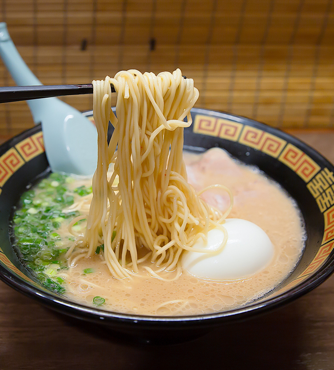 photo of chopsticks pulling up ramen out of the bowl