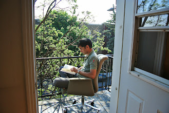 Photo: I think this is the first picture in history that Feraz actually asked me to take. Reading on the balcony in our Montreal rental.