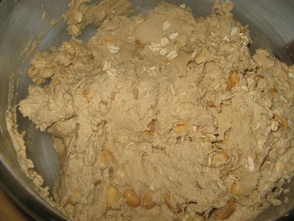 Remove  mixing bowl from stand and stir in the peanuts and  oats...
