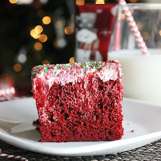Red Velvet Poke Cake with Cream Cheese Cool Whip Frosting.