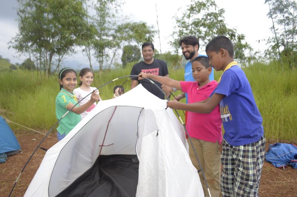 Kids setting up camp