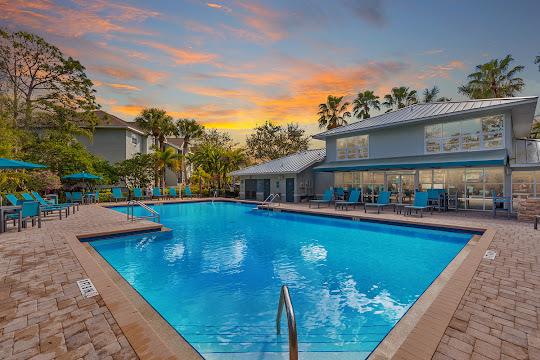 Meadow Brook Preserve's resort-style swimming pool at dusk