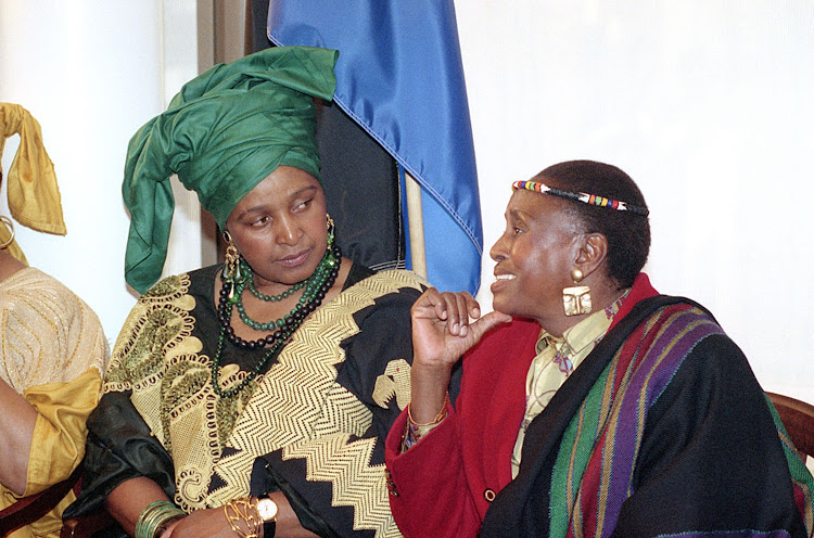 Winnie Madikizela-Mandela (left) chats to singer Miriam Makeba on June 11 1991; the colours of her outfit are a subtle nod to the ANC.