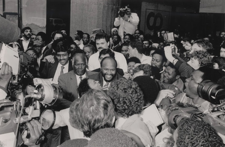 Murphy Morobe, Vusi Khanyile and Mohammed Valli Moosa after being released on October 19 1988. They and Clifford Ngcobo had found refuge in the US consulate.