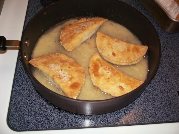 Fry each side until lightly golden brown. Remove and place on cookie sheet lined...