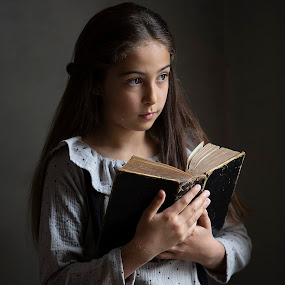 dreamy by Christoph Reiter - People Portraits of Women ( light, book, brown eyes, dreamy, girl, brown hairs )