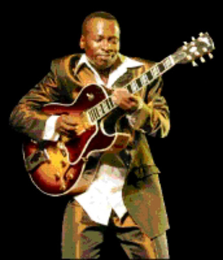 HAPPY: Selaelo Selota unvelied his new guitar at the Birchwood on Friday.  Pic. Pat Seboko. 09/07/2008. © Sowetan.