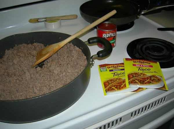 Prepare the meat filling:Brown the ground beef in a large, high-rimmed, frying pan. Drain...