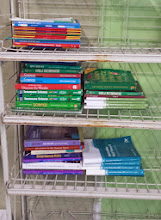 Photo: science, history, social studies books & workbooks.