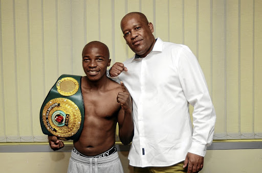 "Moruti ""BabyFace"" Mthalane and promoter Tshele Kometsi ahead of the boxer's fight against Dalisizwe Komani last November. / Mduduzi Ndzingi"