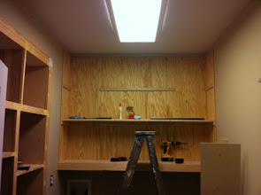 Photo: And the first shelf is up.