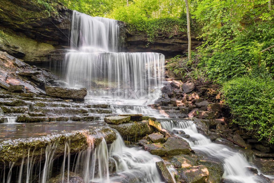 West Milton Cascades by Kenneth Keifer - Landscapes Waterscapes ( splash, miami county, stone, rock, forgotten, nature, levels, boulders, overlook park falls, west milton, midwest, cliff, forest, west milton cascades, plunging, plunge, rural, motion blur, trees, overlook park, tiers, cataract, stream, rocky, waterfall, sandstone, blur, landscape, tiered, ohio, secluded, creek, long exposure, rocks, flowing, shelves, beautiful, cascades, scenic, woods, blurred, west milton waterfall, splashing, hidden, secret, cascading, multi-tiered, scenery, whitewater, ledges )