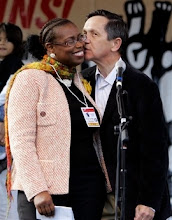 Photo: Former Rep. Cynthia McKinney, D-Ga., left, receives a kiss from Democratic presidential hopeful, Rep. Dennis Kucinich, D-Ohio, after he delivered remarks, while speaking at the 18th annual protest of the Army school at Fort Benning, which trains Latin American soldiers, police, and government officials Sunday Nov. 18, 2007, in Columbus, Ga. (AP Photo/Rob Carr)