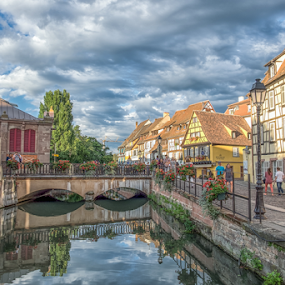 Streets of Colmar by Nitescu Gabriel - Buildings & Architecture Homes ( cityscapes, reflection, europe, street, beautiful, reflections, architecture, cityscape, city, european, sunset, france, bridge, river, colmar )