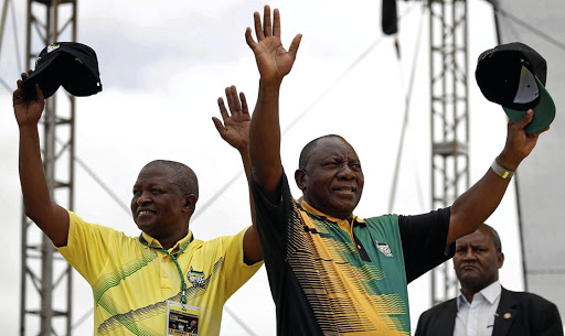 Making waves: ANC president Cyril Ramaphosa, right, and his deputy, David Mabuza, greet supporters at the party's 106th anniversary celebrations in East London. Picture: REUTERS