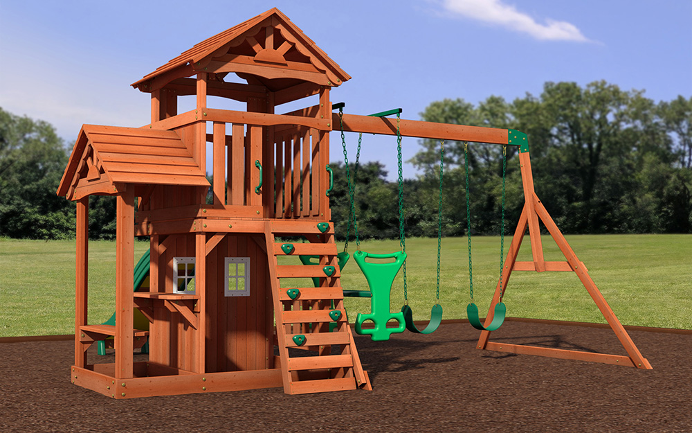 A wooden swing set features swings and a climbing wall.