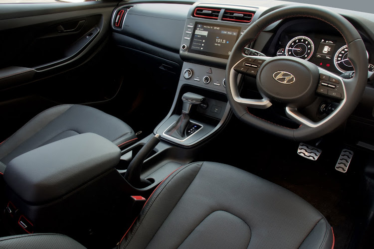 Colour accents and an uncluttered dashboard make for an appealing interior ambience. Picture: SUPPLIED