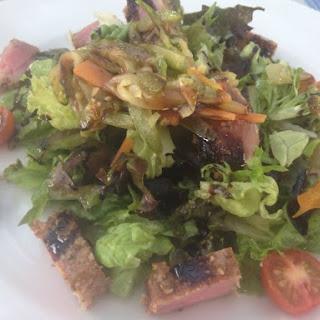 Seared fresh TUNA MEDITERRANEAN SALAD * carrots, lettuce, tomatoes * vinaigrette dressing *.