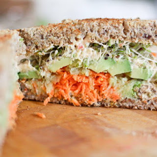 Vegan Humdinger – Hummus, Carrot, Cucumber, Avocado, and Alfalfa Sprouts Sandwich