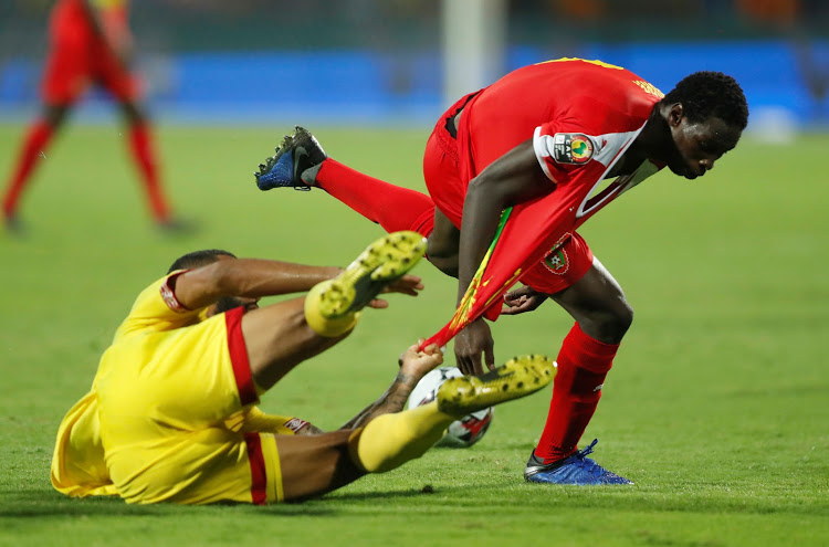 Benin's Cebio Soukou in action with Guinea-Bissau's Braima Jorge in the 2019 Africa Cup of Nations