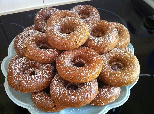Pumpkin Spiced Baked Donuts With Lemon Glaze And Dusted With Powdered Sugar.