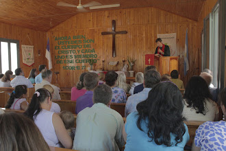 Photo: Rev. Witzke preaches on Sunday morning at the central congregation of his parish.