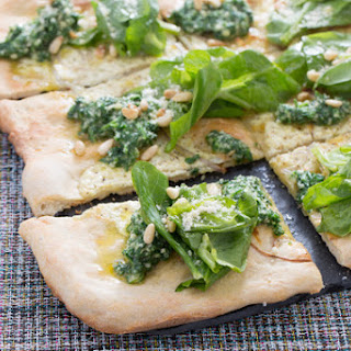 White Pizza with Arugula Pesto, Pine Nuts & Pea Tips.
