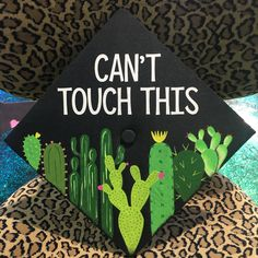 """A graduation cap that reads """"Can't touch this."""""""
