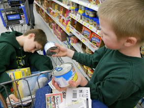 Photo: They boys got in on the game matching coupons to products. $.50 off 2 cans of dole pineapple.