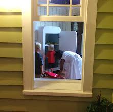 Photo: stocking the fridge