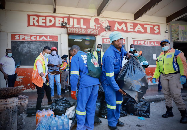 Bags of meat are confiscated at the Redbull Meats butchery at the Baragwanath taxi rank in Diepkloof, Soweto.