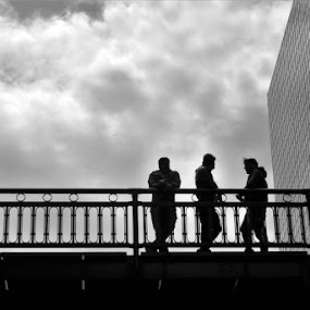 Three Chicago Men on a Bridge by Don Cailler - Black & White Street & Candid ( buildings, chicago, bridge, men,  )