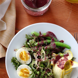 Frisée with Spring Peas and Kalamata Olive Dressing