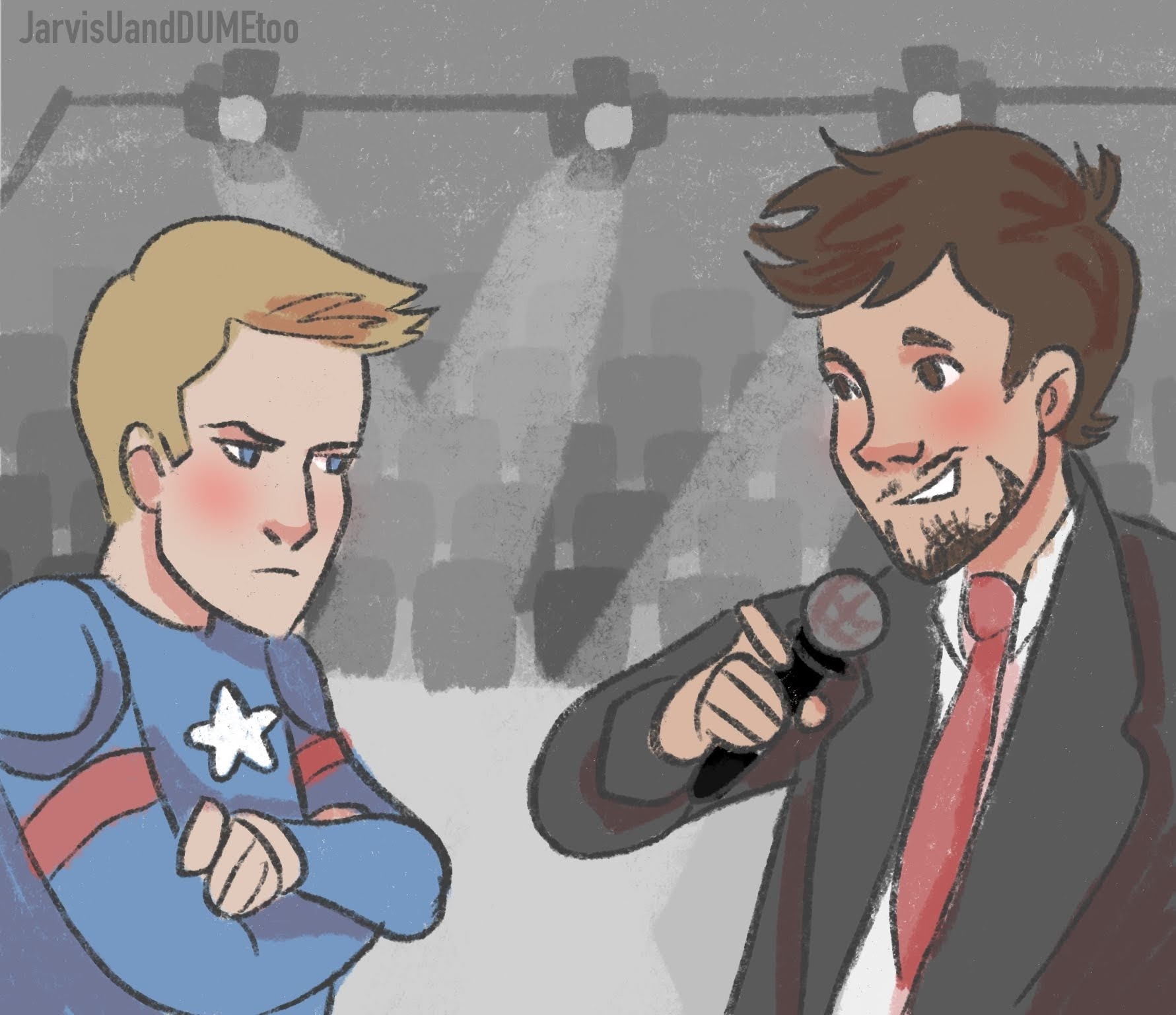 Tony is interviewing Steve. Steve is in a cheap looking version of the Captain America suit and looks angry. Behind them there is a empty auditorium.