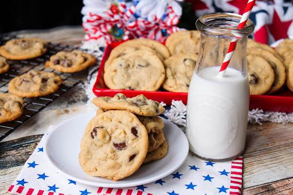 All-american Chocolate Chip Cookies With A Glass Of Milk.