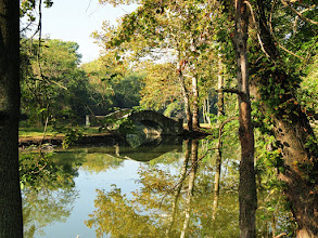 Photo: Stone bridge over a reflective pond in the autumn forest at Eastwood Park in Dayton, Ohio.