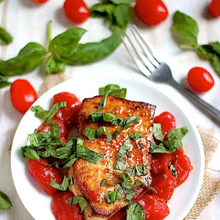 One-Pan Sicilian Swordfish with Spicy Olive Oil Poached Tomatoes