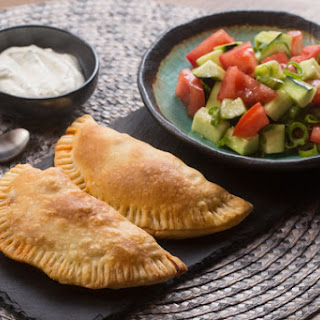 Empanadas de Picadillo with Tomato-Cucumber Salad & Lime Crema
