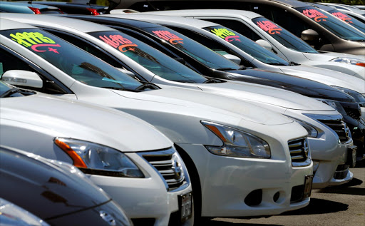Vehicles line up to catch the customer's eye at a car dealership.