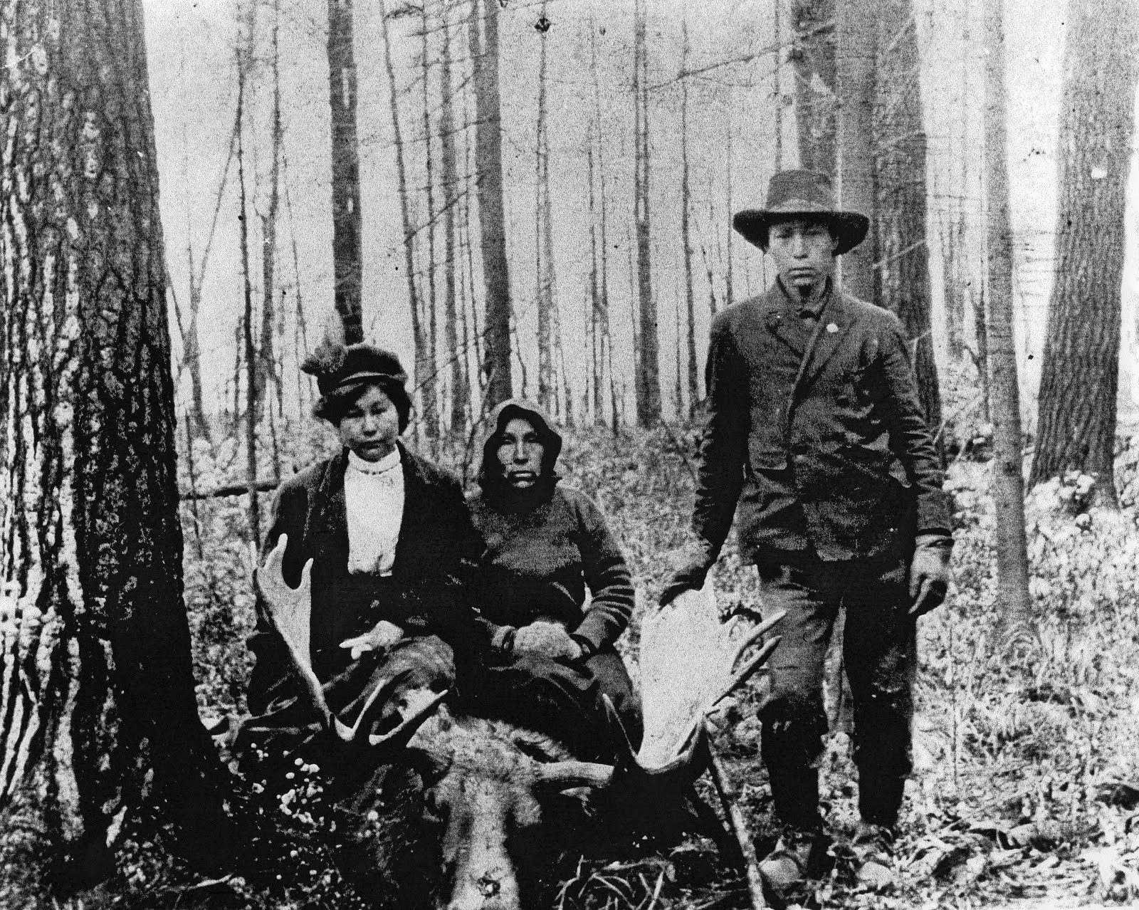 Photo: After Espagnol died in 1907, his daughter, Maggie, and her stepmother, Sarah (Louis' third wife), remained living on the island where the former trading post was located and it became known as 'Maggie's Island'. The third person is John Espagnol, Maggie's brother. (Archives of Ontario)