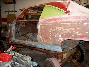 Photo: sanding the quarters down to see how many layers the other body shop layed down to cover bad metal work