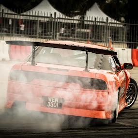 Side ways. by Michael Tan - Sports & Fitness Motorsports ( orange, drifting, malaysia, drift, nissan, smokes )