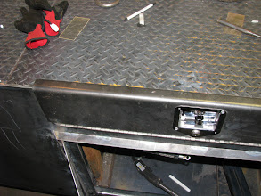 Photo: The edges will have gaskets but they will still leak a little. We have drain holes to manage any water. Inside of box will be treated with POR-15.