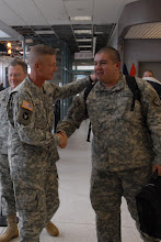 Photo: Command Sgt. Maj. Edward Mills, Minnesota State Command Sgt. Maj., shakes hands with returning OMLT member Sgt. Joey Cano.  Twelve Soldiers making up the Operational Mentoring Liaison Team (OMLT) from the Minnesota Army National Guard return from a one-year deployment to Afghanistan in support of Operation Enduring Freedom on Nov. 5.