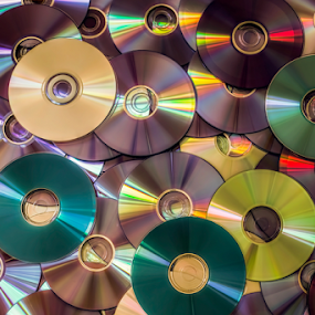 DVD disk by Roberto Sorin - Artistic Objects Other Objects ( optical, computer, reflection, ray, technology, disk, writable, data, equipment, circle, object, digital, cdrw, disc, heap, software, compact, recordable, pile, laser, cd-rw, video, closeup, backup, shiny, music, information, isolated, rom, audio, dvd, movie, cd-rom, multimedia, blue, background, rewritable, stack, media, storage, cd,  )